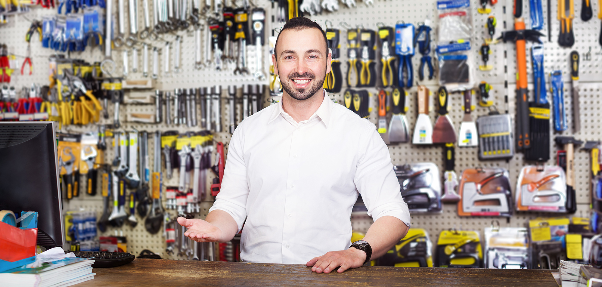 Business owner standing at point of sale in hardware store
